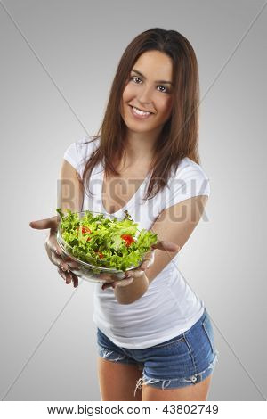 Healthy lovely woman with salad
