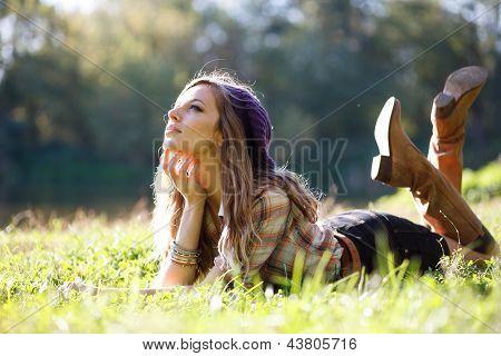 Beautiful Young Woman Lying On Grass
