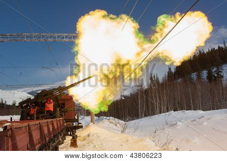 Shooting A Cannon On Railroad