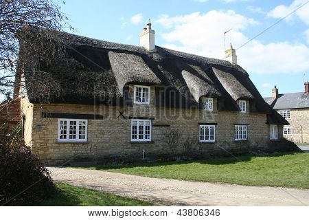 Fine thatched stone walled village building