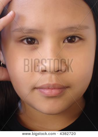 Girl Concentrating Close Up