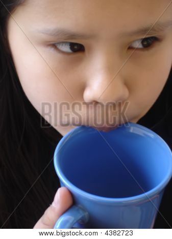 Girl Drinking From Cup