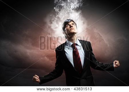 businessman in anger with fists clenched and steam above head