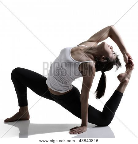 yoga, portrait of sport girl doing yoga stretching exercise, studio shot in silhouette technique over white background