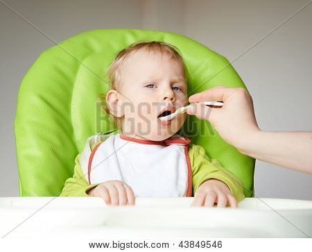 The little boy eats
