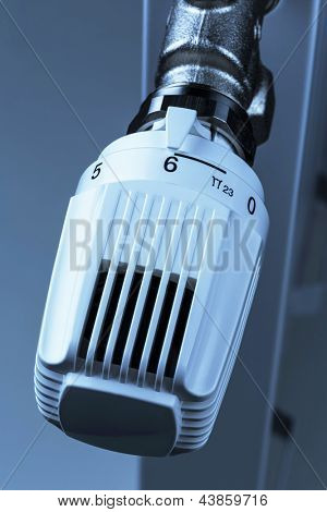 the thermostat of a radiator is turned up. high room temperature result in high energy costs