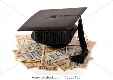 mortar board and the yen. symbolic photo for education expenses in japan.