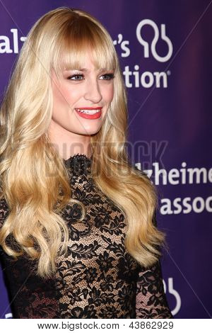 LOS ANGELES - MAR 20:  Beth Behrs arrives at the 21st Annual A Night at Sardi's to Benefit the Alzheimer's Association at the Beverly Hilton Hotel on March 20, 2013 in Beverly Hills, CA