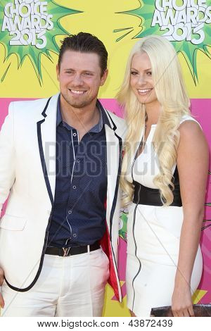 LOS ANGELES - MAR 23:  Mike 'The Miz' Mizanin, Maryse Ouellet arrives at Nickelodeon's 26th Annual Kids' Choice Awards at the USC Galen Center on March 23, 2013 in Los Angeles, CA