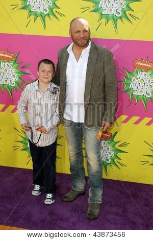 LOS ANGELES - MAR 23:  Randy Couture arrives at Nickelodeon's 26th Annual Kids' Choice Awards at the USC Galen Center on March 23, 2013 in Los Angeles, CA