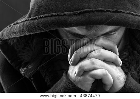 Despair bandit praying God for forgiveness