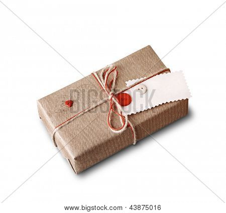 Craft gift box with blank gift tag isolated on white background.