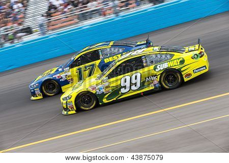 AVONDALE, AZ - MAR 03, 2013:  Ricky Stenhouse, Jr. (17) and Carl Edwards (99) battle for position during the Subway Fresh Fit 500 at Phoenix International Raceway in Avondale, AZ on Mar 03, 2013.