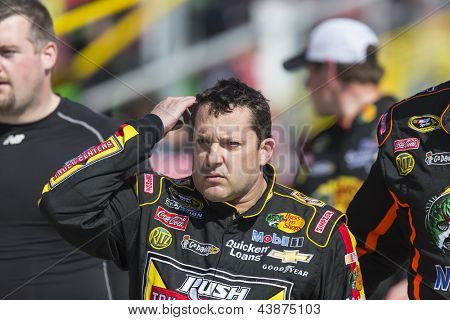 FONTANA, CA - MAR 24, 2013: Tony Stewart (14) walks off pit road after an altercation with Joey Logano at the end of the Auto Club 400 race at the Auto Club Speedway in Fontana, CA on March 24, 2013.