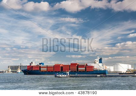 Large container ship entering Antwerp harbor - all brands and logos have been removed