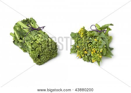 Fresh Japanese baby broccolini and broccolini with a purple string on white background