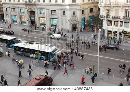 MADRID - MARCH 8: Pedestrians walk at Gran Via street on March 8 2012 in Madrid, Spain. In late 1930s, modern Gran Via while called Avenida de Rusia.