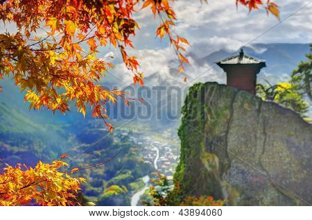 Yamadera is a mountain temple. selective focus on foreground fall leaves.