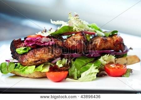 Club Sandwich with whole wheat bread baguettes, fresh salads, vegetables, brie cheese and sun-dried tomato cream