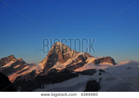 Grand Cornier (3962m) left and Dent Blanche (4357m) centre. Behind the Grand Cornier but still visible the Weisshorn and the Zinal Rothorn. poster