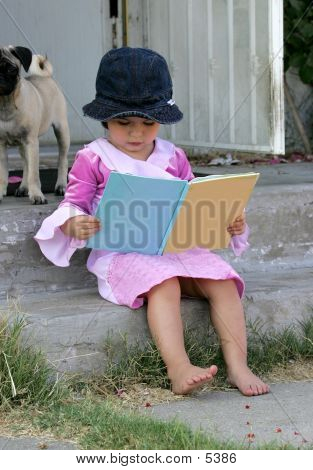 Child Reading A Book Outside