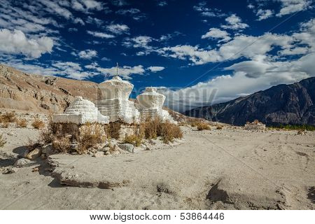 Whitewashed chortens (Tibetan Buddhism stupa) in Himalayas. Nubra valley, Ladakh, India