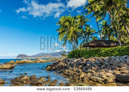 A view of the leeward coast and the Waianae Mountain Range from a secret beach at Ko Olina resort on west Oahu Hawaii poster