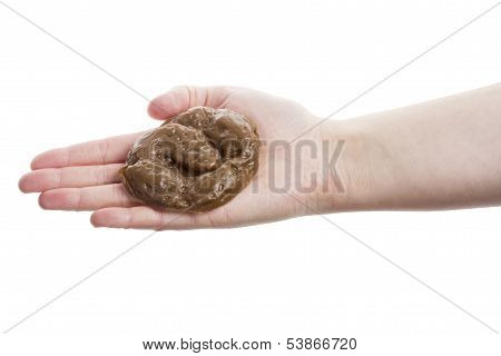 Hand holding fake rubber excrement isolated on white background poster