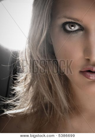 Half Face Portrait Of A Beautiful Blond Woman