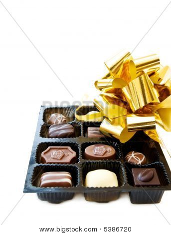 Celebrating A Special Day With Chocolates And Festive Ribbons