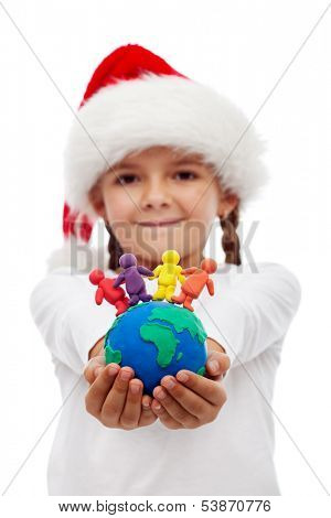 One world of happy people at christmas concept - little girl holding earth and people made of clay, isolated poster