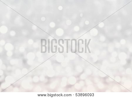 Light Silver Abstract Christmas Background With Glowing Magic Bokeh. Blurred Christmas Winter Backgr