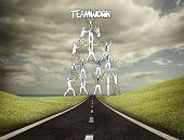 Teamwork graphic with businessmen on countryside poster