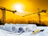 architect plan on working table with crane and building construction background poster
