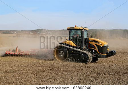 Caterpillar Challenger Tracked Tractor And Potila Seedbed Cultivator On Field