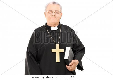 Mature priest holding a bible isolated on white background