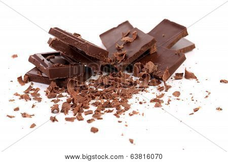 Chocolate bars and shaving.  Isolated on white background poster