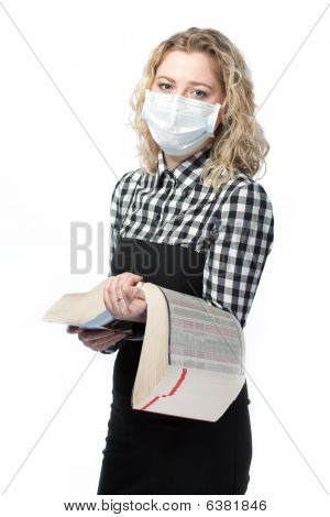 blonde with medical encyclopedia and protection mask against flu