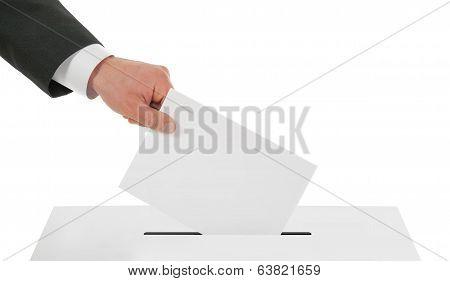 Man's hand down the ballot in the ballot box.
