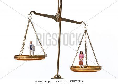 Dolls On Balancing Scales