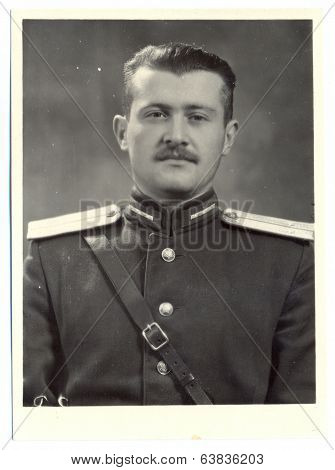 antique photo shows portrait of a Soviet Army lieutenant in uniform