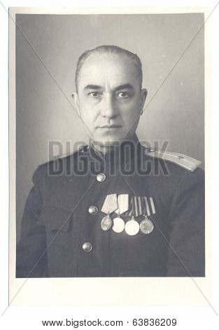 antique photo shows portrait of a Soviet Army lieutenant in uniform.