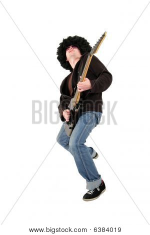 young guitarist with a wig and sunglasses playing an electrical guitar