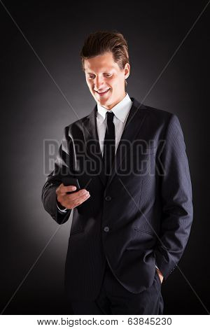 Man Looking At Cellphone