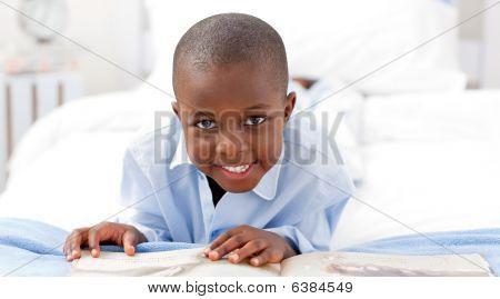 Small Boy Reading A Book