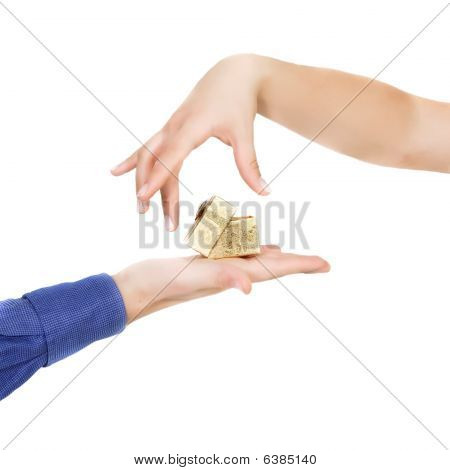 Female Hand Taking A Gift Over White