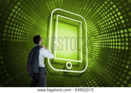 Composite image of tablet pc and businessman looking against green pixel spiral