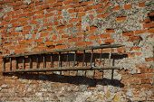 Old timber ladders on wall backgrounds horizontal. poster