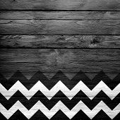 Colorful chevron pattern on wood texture background poster