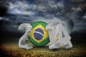 Brazil world cup 2014 against stormy sky with tornado over field poster